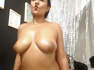 cowgirl with the toy touch her both nipples