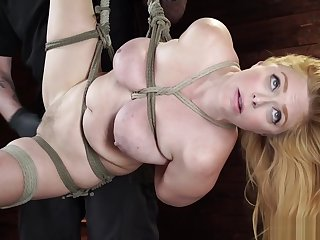 Natural busty slave is toyed on hogtie