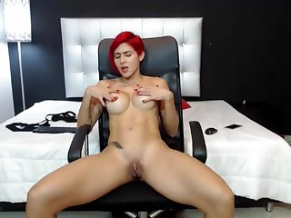 Redhead With Beamy Boobs Riding Cock On The Chair