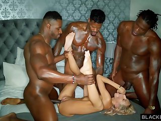 Team a few horny black guys are stretching one poor blonde cutie with their hard throbbing cocks