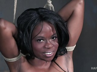 Black babe has her limits pushed by her bondage master
