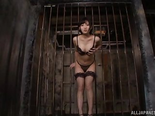 Deviating Japanese spoil in fishnet stockings moans to the fullest extent a finally riding a toy